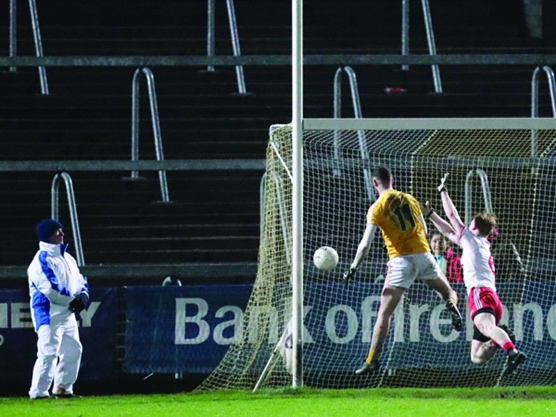 Antrim's Matthew Fitzpatrick beats Tyrone's Hugh Pat McGeary to the ball to score his side's second goal during their 4-20 to 2-11 defeat to the Red Hands in their Dr McKenna Cup opener at the Athletic Grounds last night