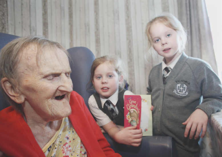 MILESTONE: Edith Manderson celebrates her 100th birthday with her great-grandchildren, Jessica and Rachel McConnell, both aged seven