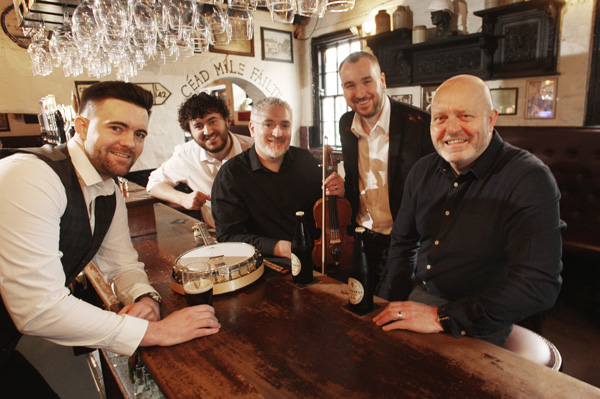 CLASS ACT: Shane McNeill, Seán Mac Corraidh, Gerry McNeill, Seán óg Mac Corraidh and Stephen Loughran in Kelly's Cellars re-enacting a famous photo of the Dubliners in Kelly's from 1968