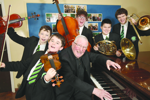RIGHT NOTE: Fr Kevin McMullan with musical pupils of St Malachy's preparing to entertain at the inaugural Alumni Recital this Thursday night