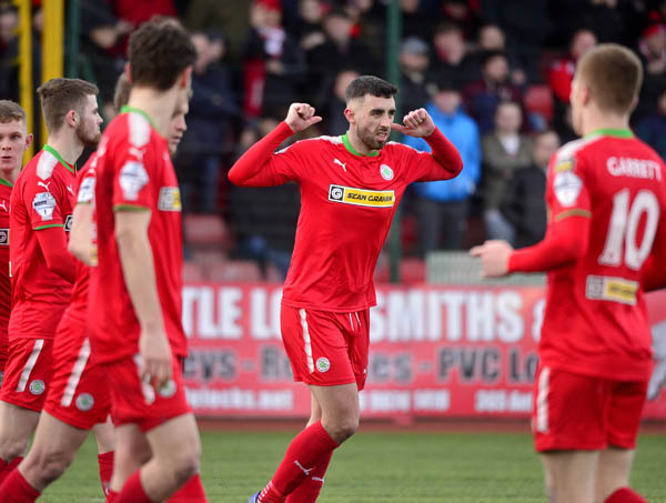 Cliftonville striker Joe Gormley celebrates after scoring his re-taken penalty during last Saturday's 4-1 win over North Belfast rivals Crusaders in the Irish Cup at Solitude