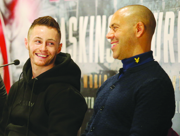 Ryan Burnett's trainer, Adam Booth (right) says his man must first win the fight before he starts thinking about putting on a show in front of the 80,000 crowd at the Principality Stadium in Cardiff on Saturday night