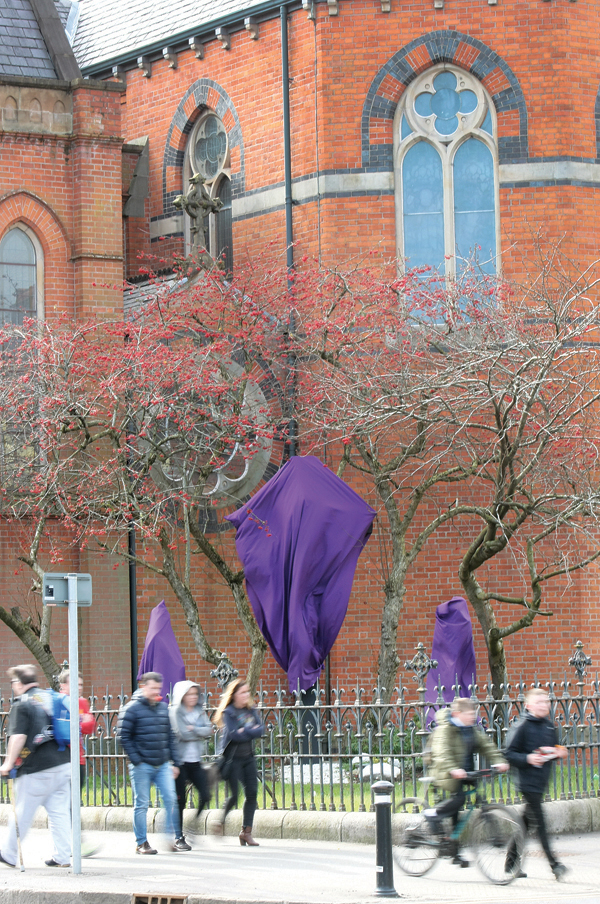 Statues outside St Paul's church on the Falls Road draped in purple cloth for the Lent tradition of Passiontide- the period between the fifth Sunday of Lent and Good Friday