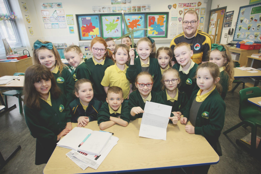 REED ALL ABOUT IT: Teacher Diarmuid Ó Tuama with his class and the letter from Taoiseach Leo Varadkar