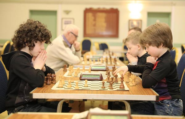 At the Ulster Rapidplay Chess Championships 2018 in Fruithill Bowling Club, Dexter Harris (9) waits for his brother Blake (6) to make his move