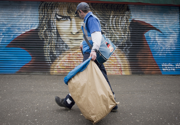 A Council street cleaner keeping North Belfast tidy under the watchful eye of a Game of Thrones artwork at Fortwilliam shops