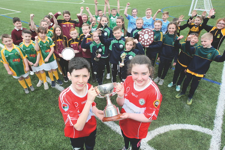The launch of the Liam Murray Cup in Coláiste Feirste with Liam and Amy Murray, along with the pupils from Irish medium schools, who will be competing in this year's competition, which starts today, Friday