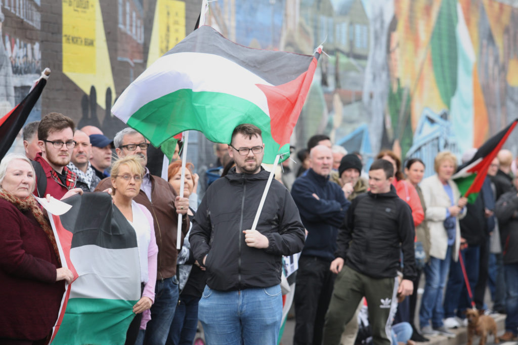 Hundreds of people took part in a Palestinian solidarity protest on Tuesday night at the International Wall on the Falls Road following the IDF killings in Gaza