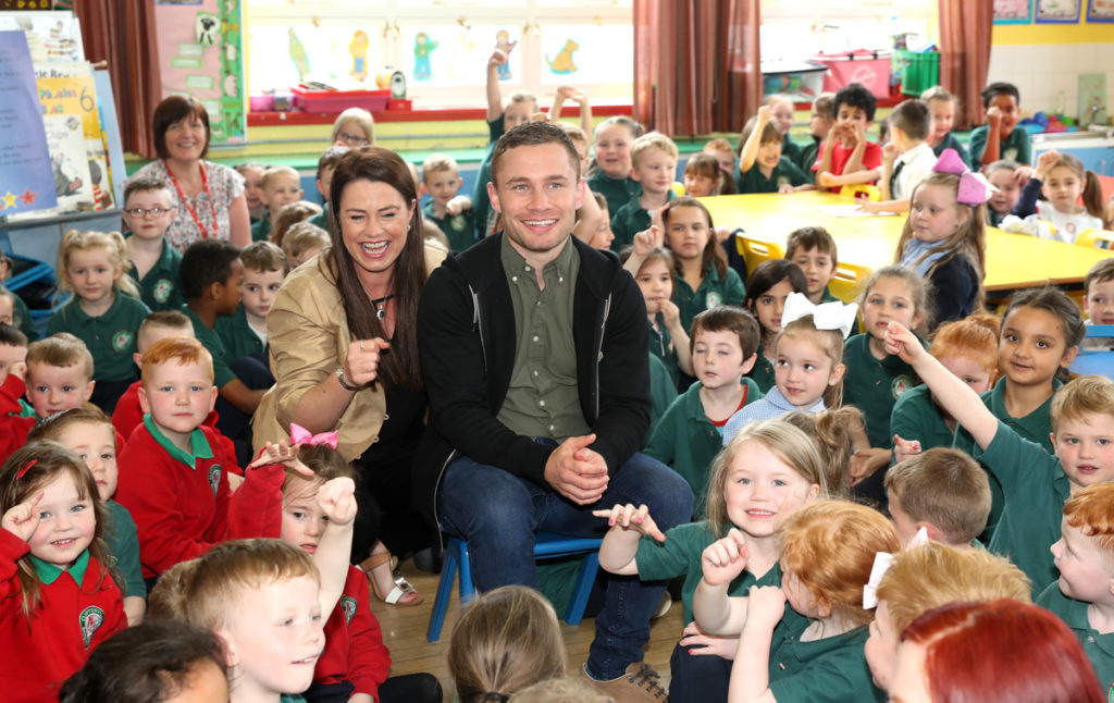 Carl Frampton with pupils from Cliftonville Integrated Primary School