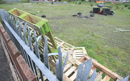 'PIGSTY': Pallets and tyres have been gathered on the green field