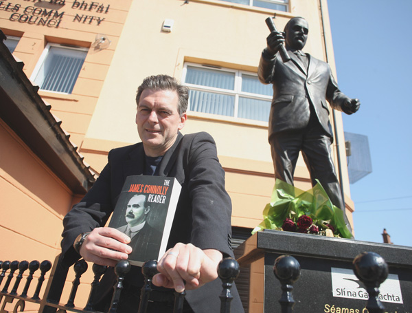 HOME FROM HOME: Shaun Harkin with his new book at the James Connolly statue on the Falls Road