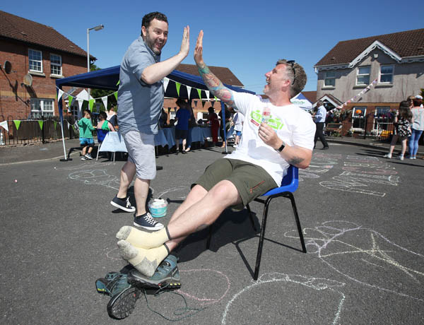 White Rise, The Big Walk, Michael Conlon finishes his walking challenge, coming home to the Big Lunch for friends, family and neighbours. pictured: Michael celebrates with his husband Gerard O'Donnell