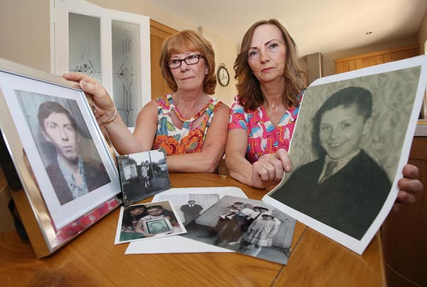 Sisters Rita Bonner and Carmel Quinn hold photos of their brother John