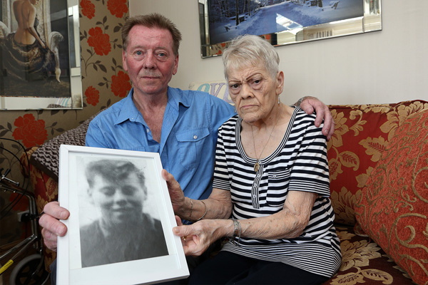 JUSTICE: Kevin Phillips and sister Lily Shanks hold a photograph of their brother Noel