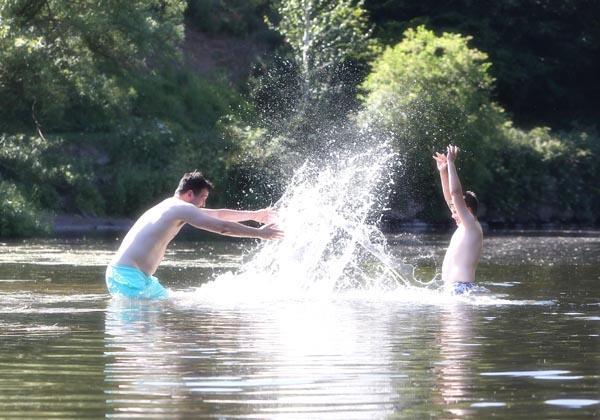 Louis Hyndman and Gerard McAnoy making a splash on the River Lagan near Minnowburn
