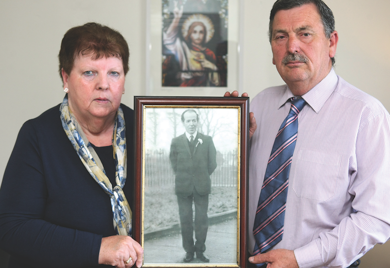 SHOT DEAD: John Teggart and Alice Harper with a photo of their father Danny