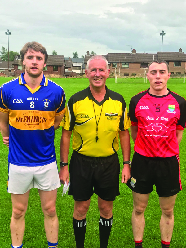 Team captains, Stephen Beatty (Rossa) and Eamonn Brady (Ahoghill) with referee, Brendan Toland before Wednesday's game
