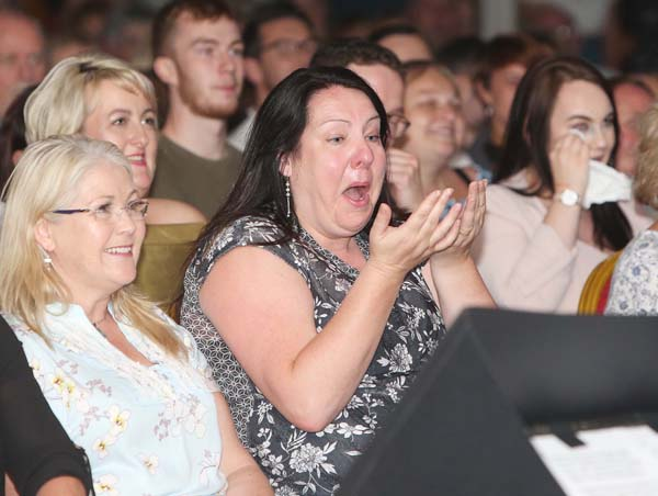 FUNNY BUSINESS: An audience member enjoying Jake O'Kane and Paddy McDonnell's Féile an Phobail comedy night performance in the Devenish on Saturday night