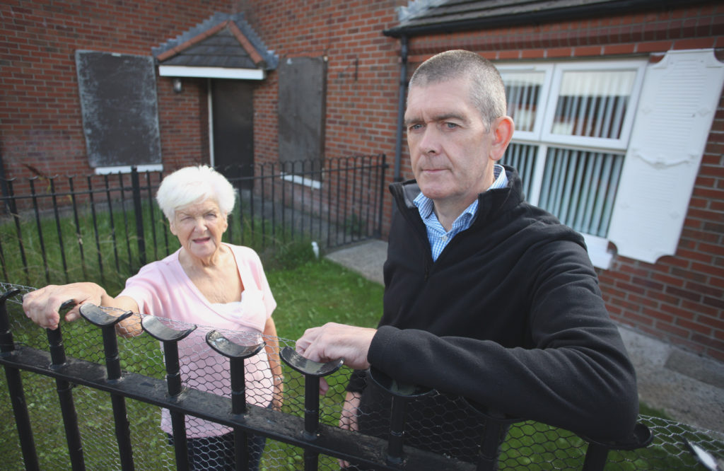 ENOUGH: Manus Maguire with resident Joan Rocks at the derelict house in Manor Close