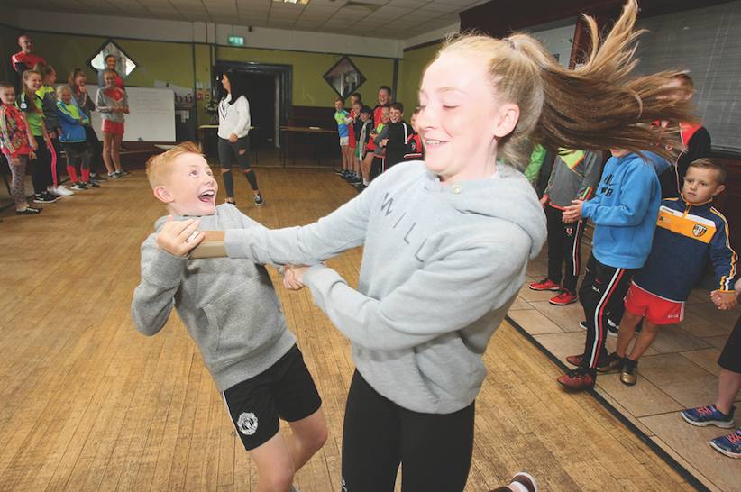 High spirits at Sceim Samhraidh at Lamh Dhearg, featuring Irish classes, mountain walks, art and GAA workshops, Ceili dancing and many other events Ronan Webb and his sister Orlaith spin down the dance lines at the Ceili.