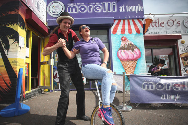Danielle McCann of Morelli at Temple  tries her hand at the unicycle during the Summer Street Fair on the Andersonstown Road at the weekend