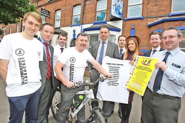 Supporting the cycle are Ó Muirigh Solictors staff Dan Ó Muirigh, Barry Woods, Kevin McDonald, Padraig Ó Muirigh, Nicholas Quinn, Pauline Ní Mhuirigh, Eoin Murphy and Niall Ó Murchu with John Teggart.