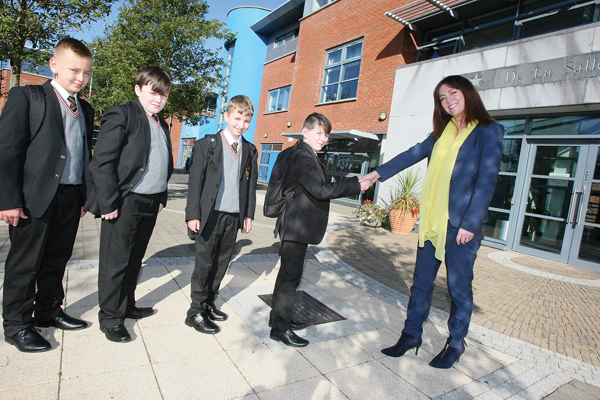 De La Salle College Key Stage 3 manager, Mrs Mairead Healy welcomes Year 8 pupils, Sean O'Hagan, Dylan Owens, Adam Mulligan and Eugene Prunty to their new school.