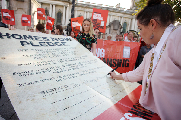 Belfast Lord Mayor Deirdre Hargey signs the Homes Now pledge outside City Hall on Monday night