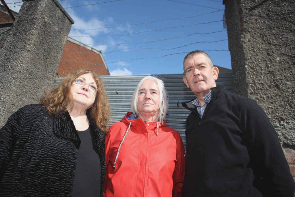 Manus Maguire from Cliftonville Community Regeneration Forum with local residents Eithne O'Kane and Terry McKeown