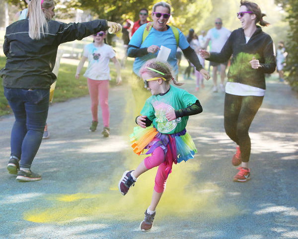 Autumn high-jinks in the Falls Park during the 'Run For Anto', a colourful event rasing funds for the motor neurone charity DeterMND, which is backed by Antrim football legend Anto Finnegan.