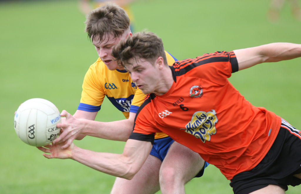A tussle for posession as St Teresa's clash with Glenavy at Sarsfields