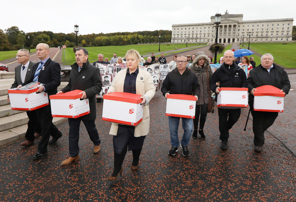 Members of the Time for Truth Campaign hand over 6,000 responses to the NIO's consultation, addressing the legacy of the past in the North