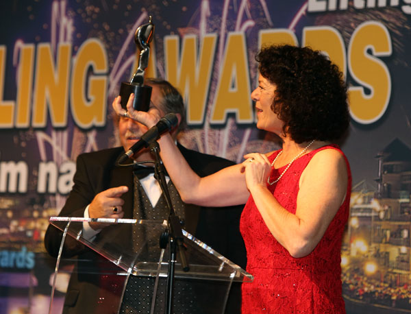 Tish Holland collecting an Aisling Award in 2012
