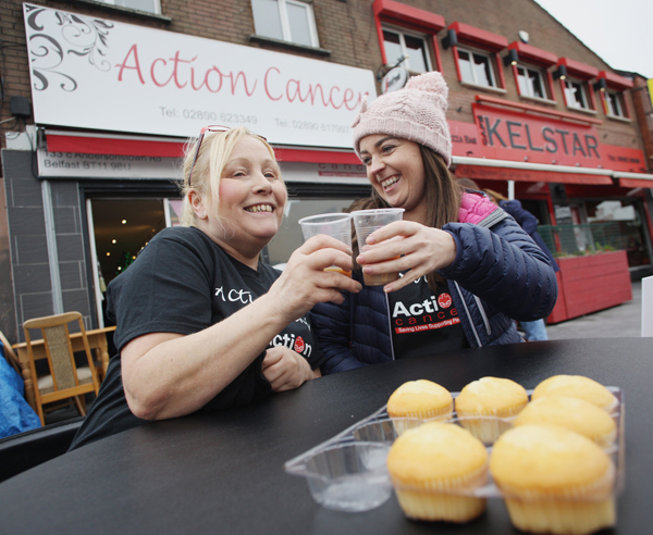 Action Cancer Andersonstown staff Teresa Ryan and Lynette Coleman taking a well-deserved break as staff from Bank of Ireland and the Andersonstown News took over the running of the shop for a day on Friday as part of the Action Cancer Store Challenge