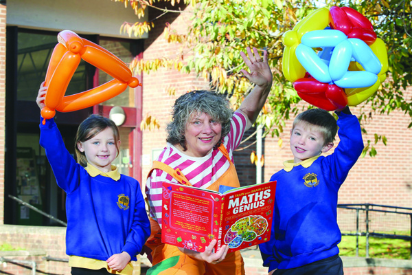 COUNT ON IT: Belvoir Park Primary School Year 3 pupils Maisie and Jude with maths entertainer Bubblz (Caroline Ainslie) outside Ormeau Road Library