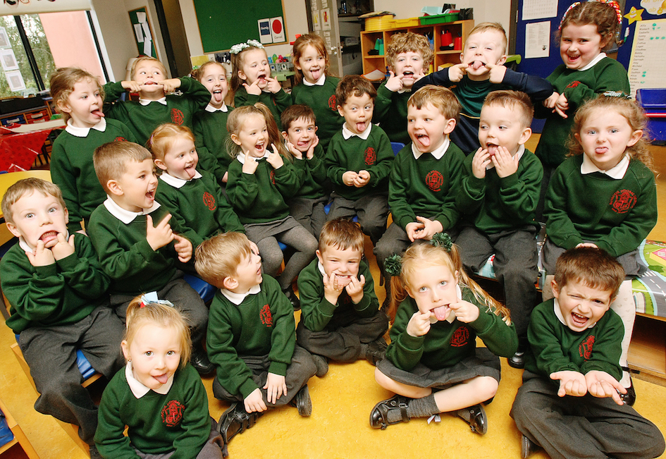 Bunscoil Phobal Feirste Rang 1 entertain the Andersonstown News photographer during a photo session for the annual Primary One Supplement, which will appear in next week's paper