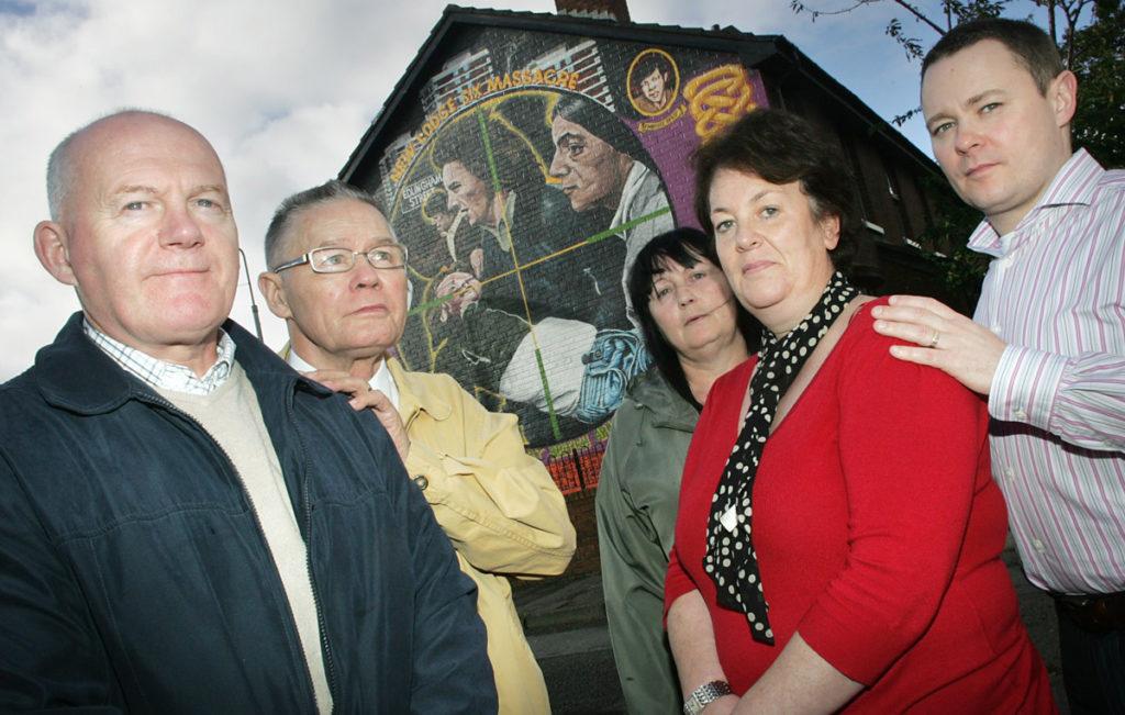 Paul O'Neill, Willie Loughran, Ann Sloan, Linda Duffy and John Loughran at the New Lodge Six mural