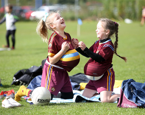 Kaila Walsh and Sophia Lockhart having fun at the St Galls Gaelic 4 Mothers tournament
