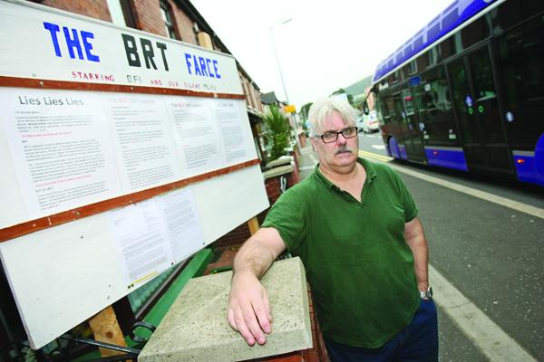 Fintan Heatley has erected a sign outside his Falls Road home entitled The BRT Farce