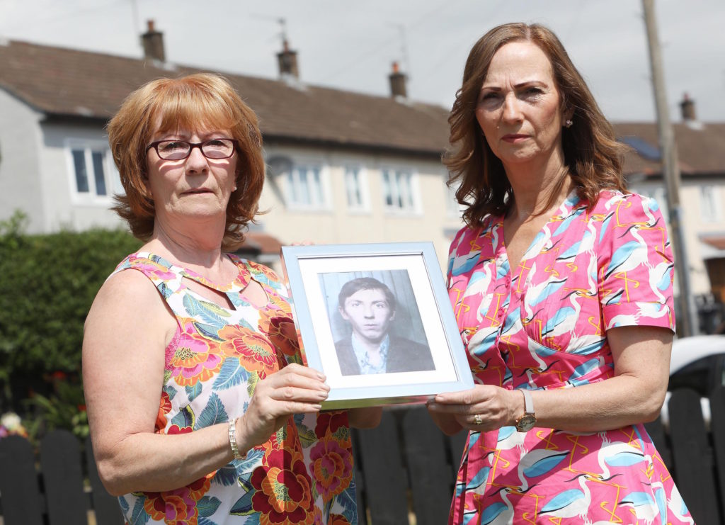Rita Bonner and Carmel Quinn with photographs of their brother John Laverty who was shot dead by British Soldiers in the Ballymurphy Massacre 1971 0607JC18