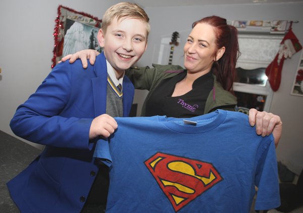 BRAVE: Neil Francis with mum Natalie and his gift from the school