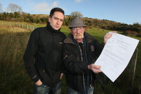 'ABSURD': Seamus Conlon and Cllr Matt Collins with the City Hall summons