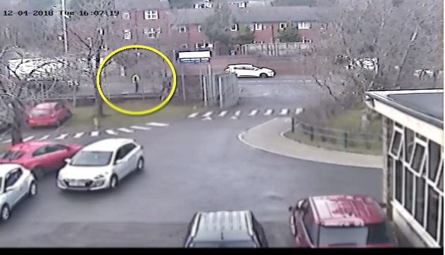 The new CCTV footage shows the gunman walking down the Glen Road outside Christian Brothers School