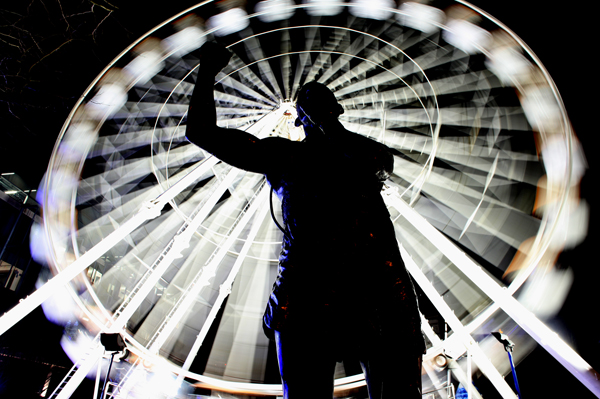 Back in the limelight: A statue of boxer Rinty Monaghan at Cathedral Gardens where it is illuminated by the big wheel, which is aimed at attracting  shoppers into the city centre in the run-up to Christmas