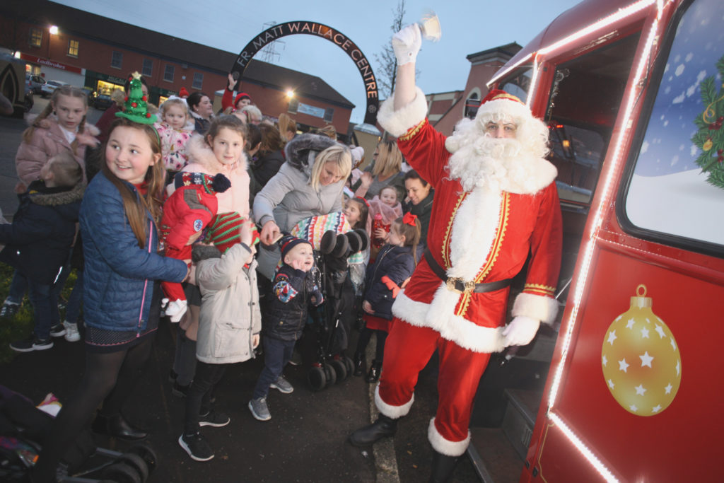 Santa from USDT picking up families to bring them to the Upper Springfield Devlopment Trust annual Christmas event on the Whiterock Road