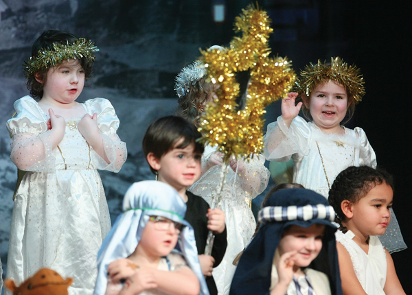 A wee angel spots her parents in the audience during the P1 Nativity at St.Teresa's Primary School.