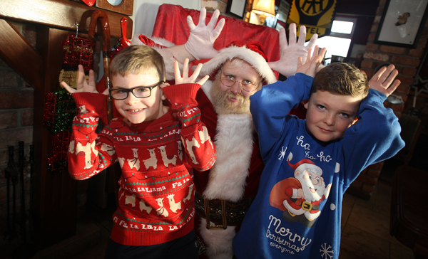 Aidan and Michael McCloskey with Santa at a charity breakfast in the Speckled Hen on the Derriaghy Road