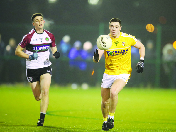 Man-of-the-match Declan Lynch breaks out of defence  Pic by John McIlwaine