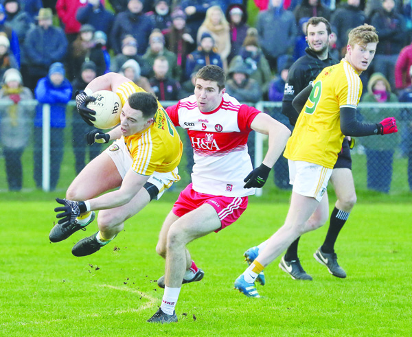 "Antrim defender Declan Lynch secures possession ahead of Derry midfielder Ciaran McFaul during last Sunday's Allianz League opener. The Saffrons suffered a narrow one-point loss at Corrigan Park and the skipper feels this Sunday's clash against Wexford is now a ""must-win"" game for Antrim"