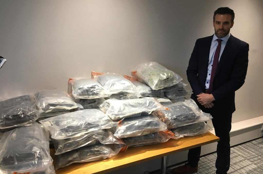 Detective Superintendent Bobby Singleton with approximately 50kg of herbal cannabis with an estimated street value of just under £1million